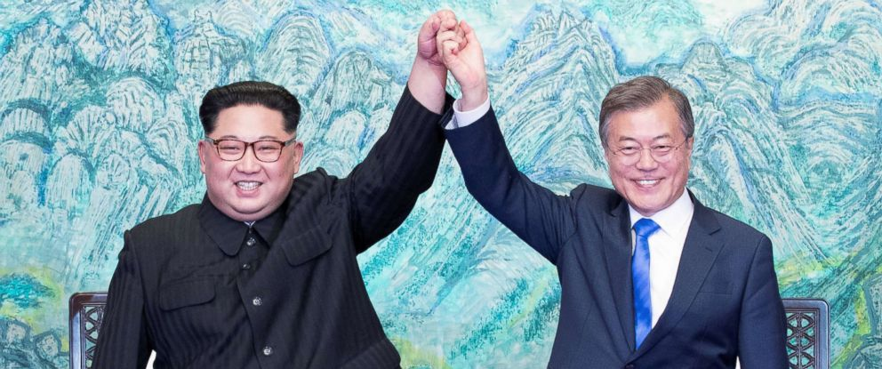 PHOTO: North Korean leader Kim Jong Un and South Korean President Moon Jae-in raise their hands at the truce village of Panmunjom inside the demilitarized zone separating the two Koreas, South Korea, April 27, 2018.