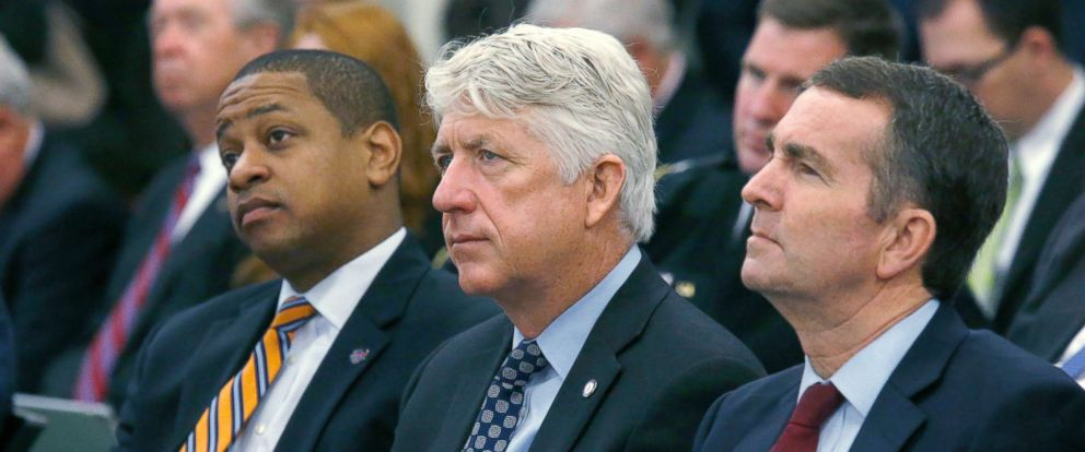 PHOTO: Lt. Governor-elect Justin Fairfax, Atty. General-elect Mark Herring and Governor-elect Ralph Northam listen as Virginia Governor Terry McAuliffe addresses a joint meeting of the House and Senate money committees in Richmond, Va., Dec. 18, 2017.