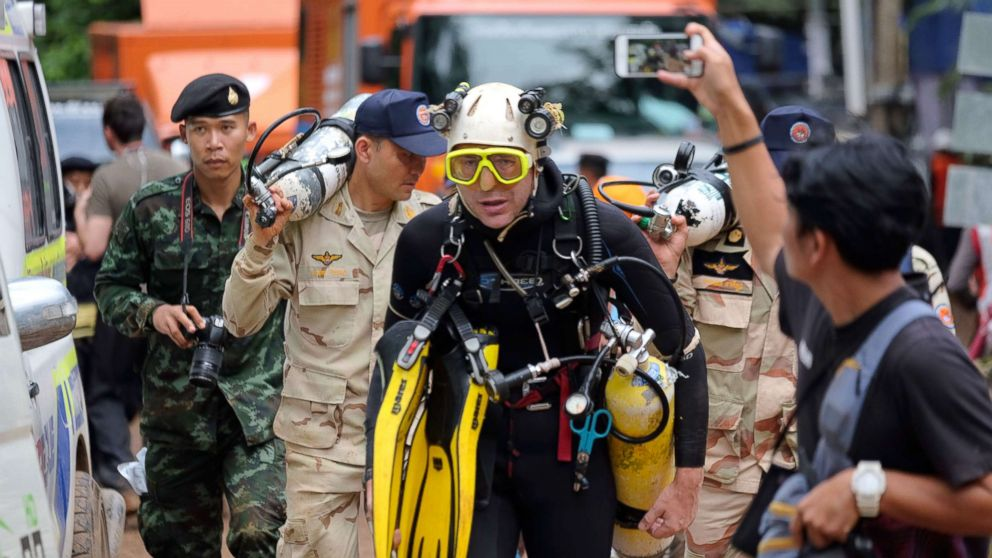 "British cave-diver John Volanthen walks out from Tham Luang Nang Non cave in full kit without any response to reporter's questions, June 28, 2018 in Chiang Rai, Thailand. Twelve boys and their football coach trapped in a flooded Thai cave for nine days were ""found safe"" on late July 2, in a miracle rescue after days of painstaking searching by divers."