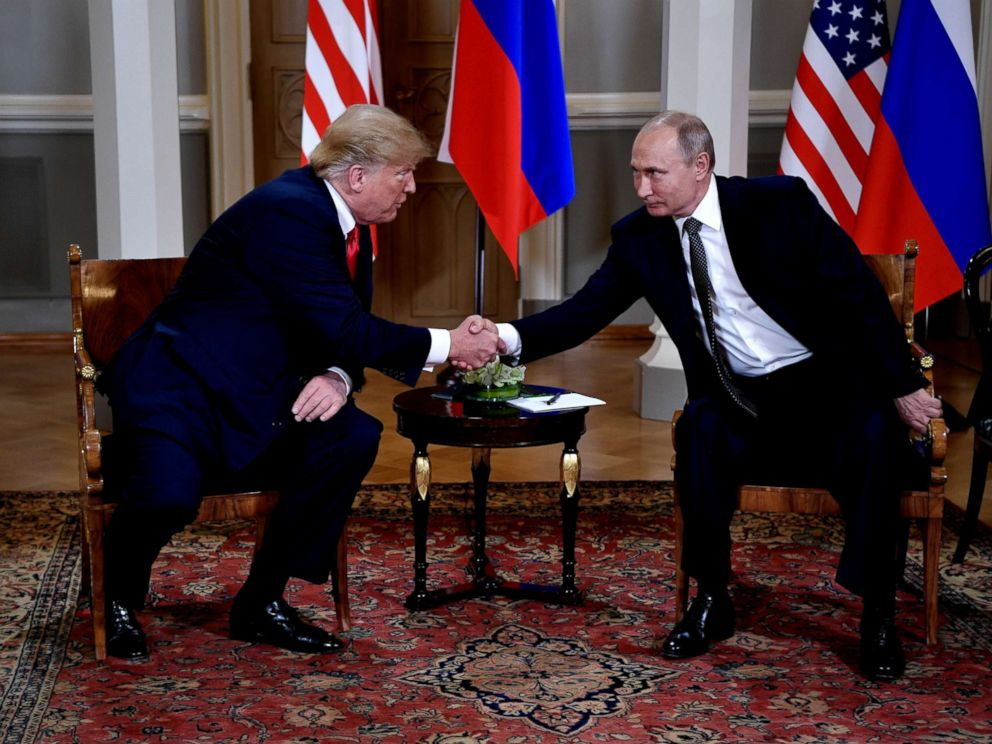 PHOTO: President Donald Trump and Russian President Vladimir Putin shake hands during their one-to-one meeting at the Presidential Palace in Helsinki, Finland, July 16, 2018.