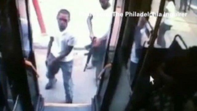 PHOTO: Men outfitted with weapons attack a Philadelphia bus, August 4, 2011, Philadelphia, Pa.