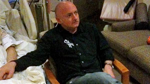 Photo: Astronaut Mark Kelly watches the State of the Union address at his wifes bedside