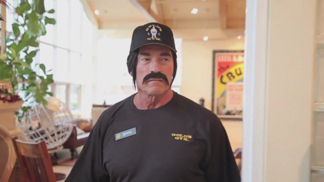 Arnold Schwarzenegger Disguised as Golds Gym Employee