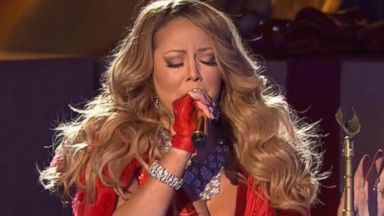 now playing mariah shows up finally now playing mariah careys all i want for christmas sung