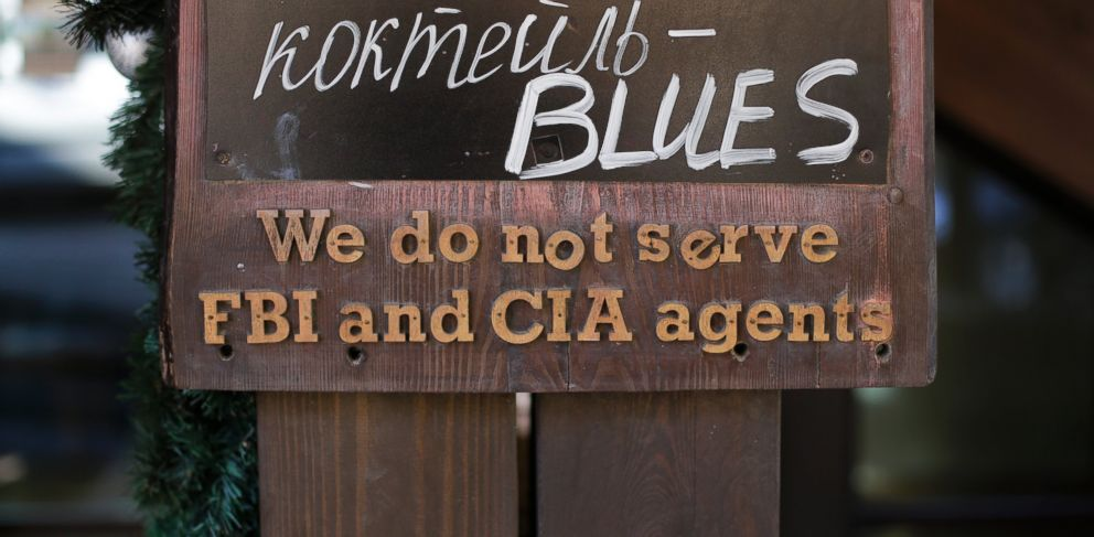 "PHOTO: A sign that says ""We do not serve FBI and CIA agents"" hangs outside a restaurant on the opening day of the 2014 Winter Olympics, Feb. 7, 2014, in Krasnaya Polyana, Russia."