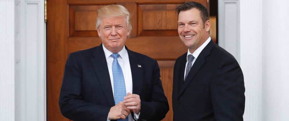 PHOTO: In this Nov. 20, 2016, file photo, Kansas Secretary of State Kris Kobach, right, holds a stack of papers as he meets with President-elect Donald Trump at the Trump National Golf Club Bedminster clubhouse in Bedminster, N.J.