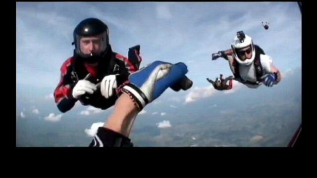 VIDEO: Mid-air rescue at 12,000 feet saves a skydiver whose chute did not open.