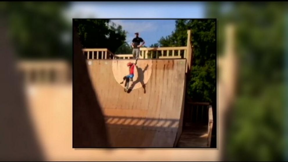 Father Coaching His Child Appears to Kick Son Down Ramp in Skate Park