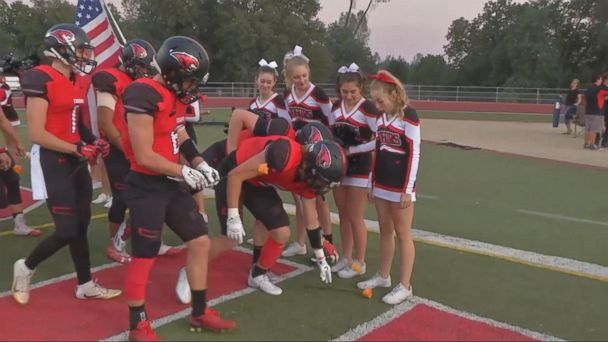High School Football Team Takes to the Field for Cheerleader With Leukemia