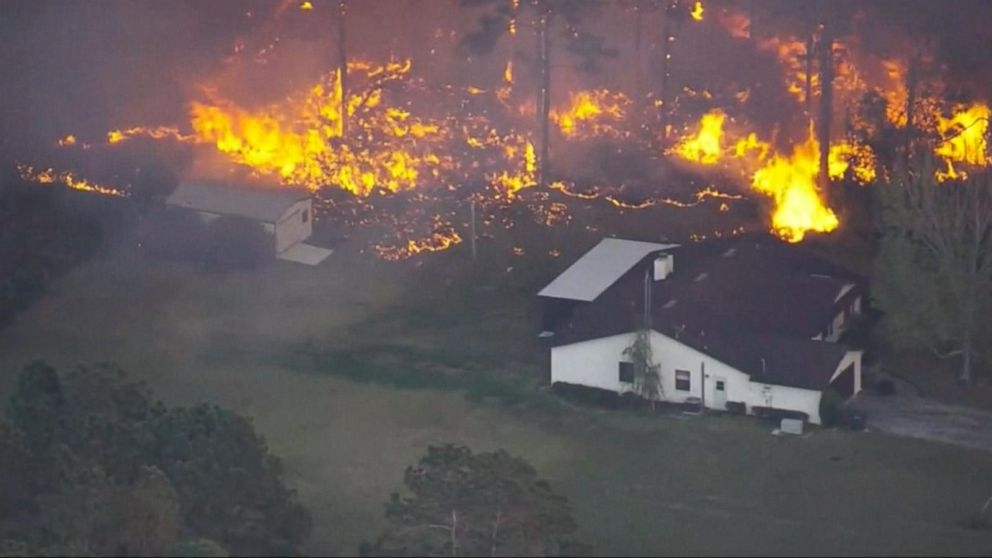 Firefighters battle more than a hundred wildfires in Florida