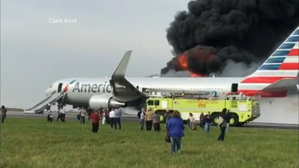Crew springs into action after an American Airlines plane catches fire  during takeoff