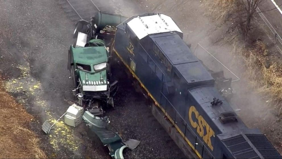 Freight train slams into tanker truck carrying hydrochloric