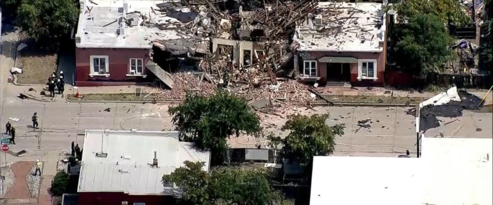 A portion of a brick rowhouse was leveled in Tuesdays blast just south of downtown Denver.