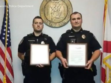 WATCH:  Officers rush into burning apartment to save lives