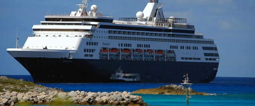Holland America said the 70-year-old woman was moving between the ship and a smaller boat when she fell.