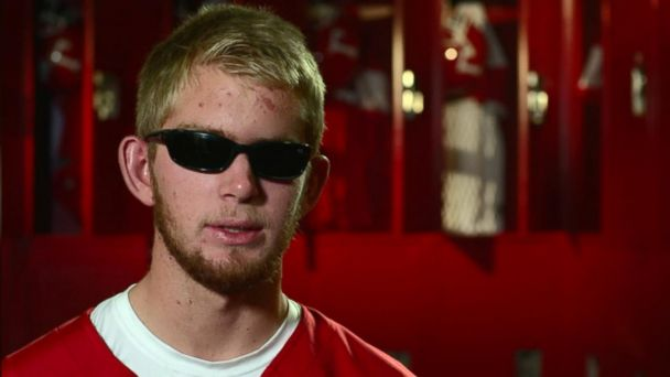 Blind USC football player walks the field one last time