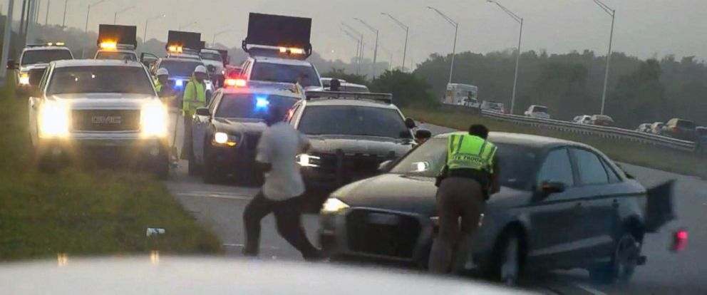 The officer is in critical condition, police said, after he was hit while standing on the side of an interstate in Florida.