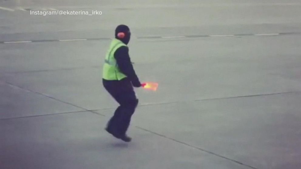 Airline worker's dance moves bring smiles and goes viral