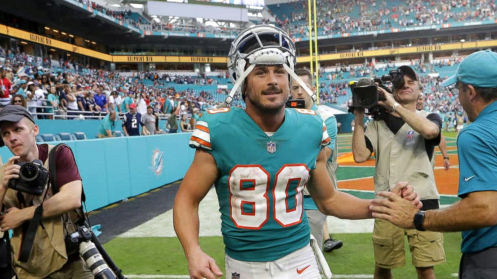sports shoes 8e62e a2d77 Dolphins receiver Danny Amendola meets with young fan