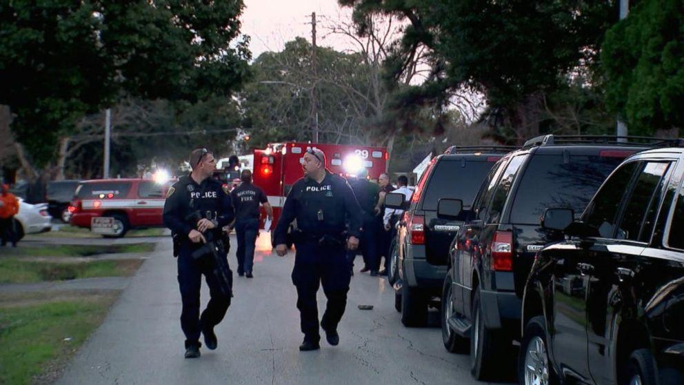 Woman among 2 suspects shot dead in Houston drug raid that left 5
