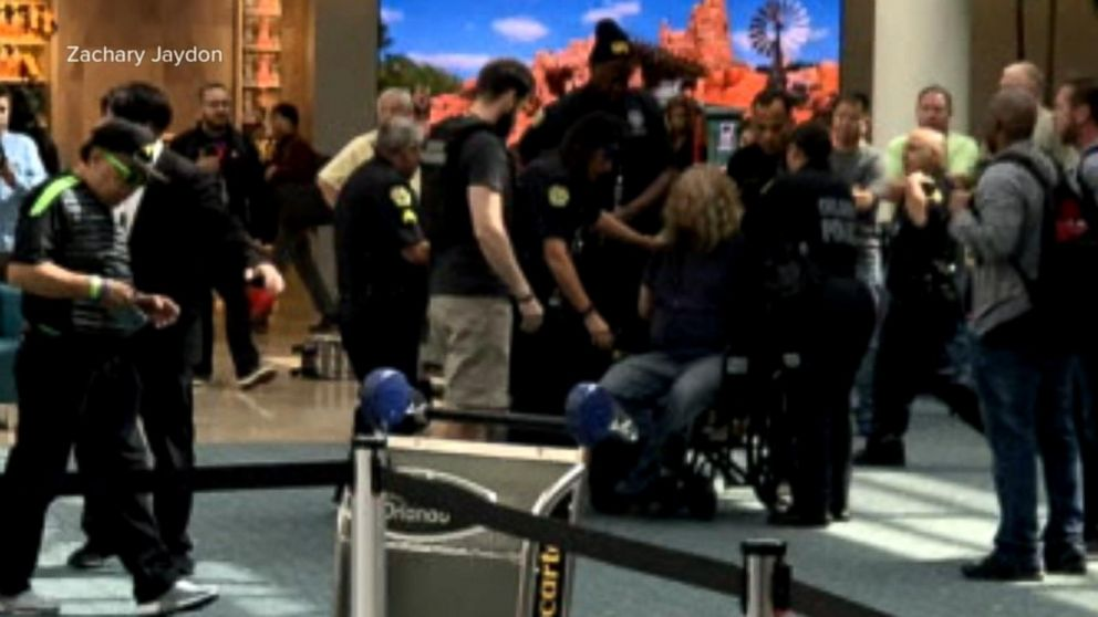 WATCH:  Police detained a man who tried to breach airport security in Orlando