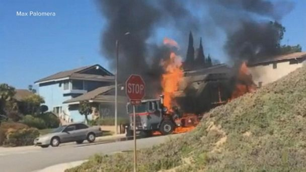 Garbage truck engulfed in flames, barrels downhill outside Los Angeles