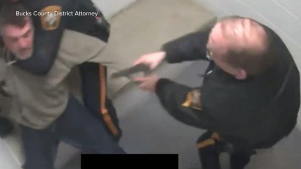 Video shows a police officer shooting a man at point blank range while in custody