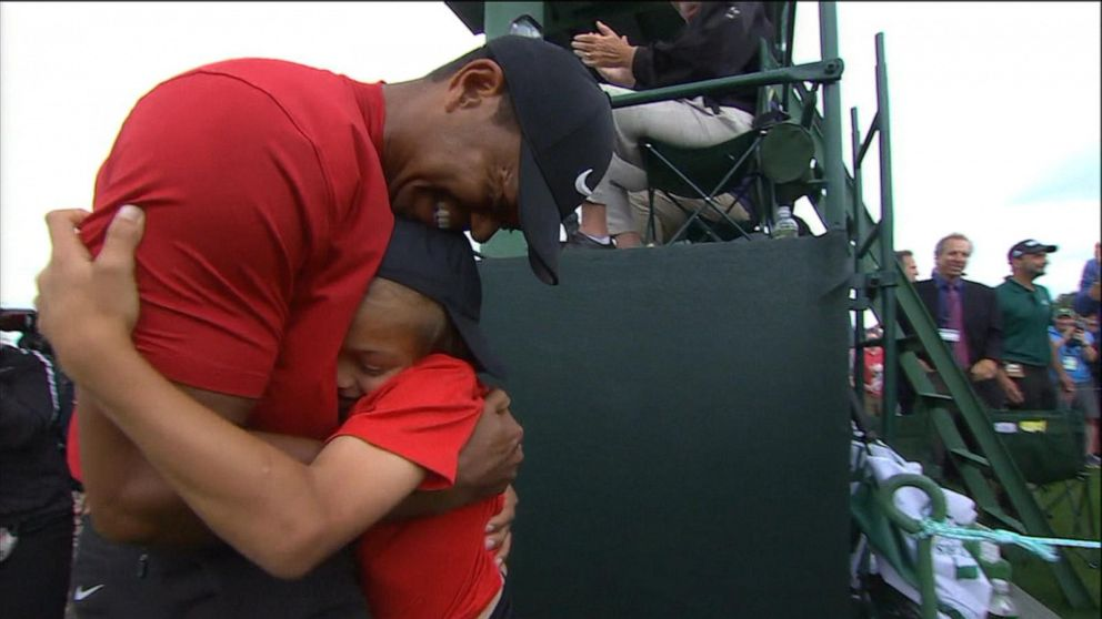 tiger woods celebrates with his 2 children after winning fifth masters video