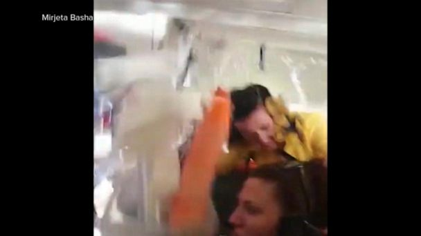 Video shows a flight attendant hitting the ceiling of a 737 jet during rough air