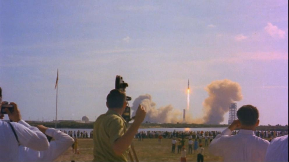 What awaited the astronauts when they returned to Earth after the Apollo 11 moon landing?