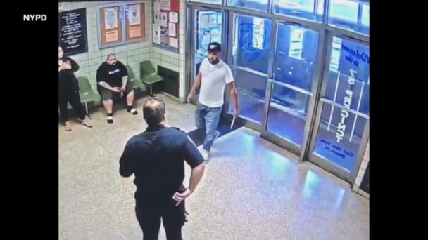 Armed man walks into an NYC police precinct