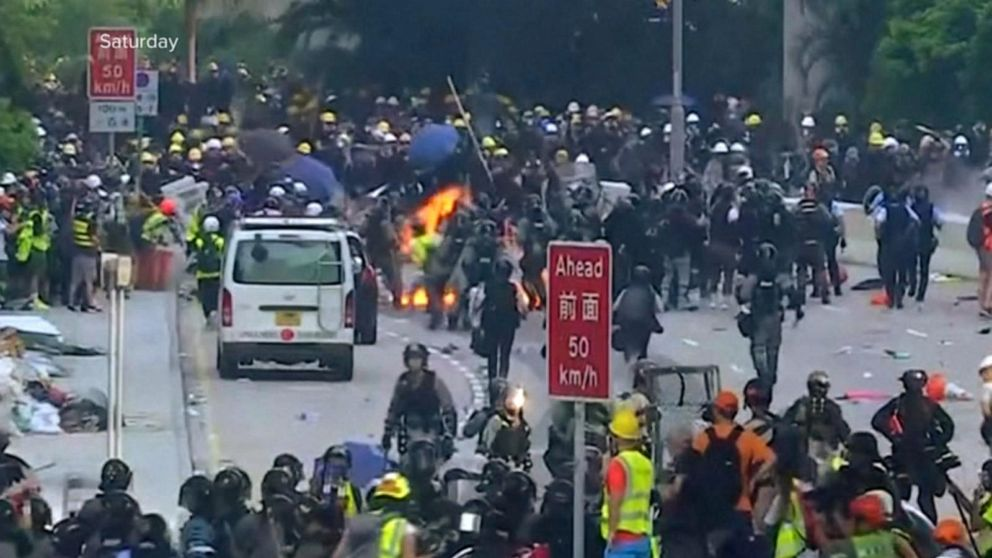 Protests in Hong Kong grow dangerous as shots of live ammunition can be heard