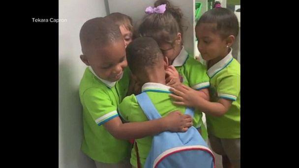 Preschool students welcome Hurricane Dorian survivor with hugs