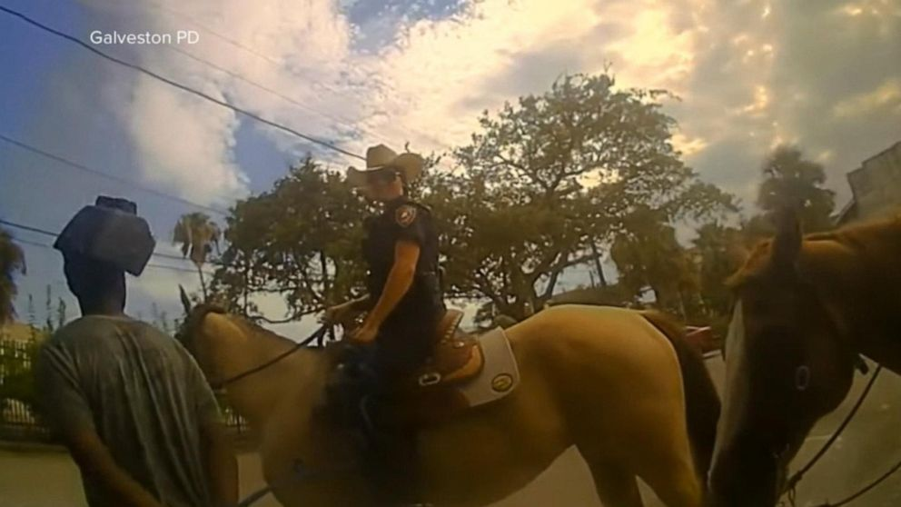 Newly released footage shows police on horseback walking a handcuffed man by rope