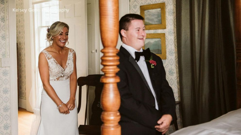 Woman captures tearful moment her brother sees her dressed as a bride