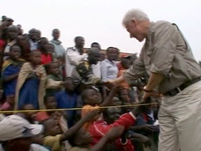 Bill Clinton shaking hands with children