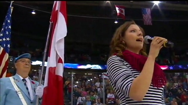 VIDEO: Team and fans look puzzled as Canadian singer belts out own rendition of U.S. anthem.