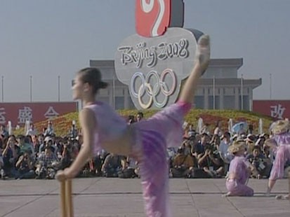 Girl infront of Olympics sign