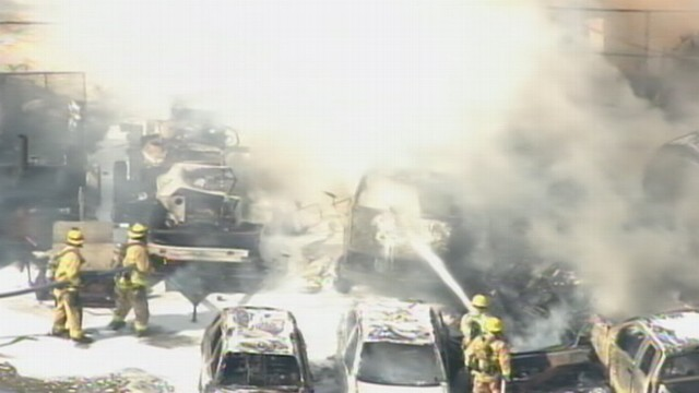 VIDEO: Firefighters rush to put out the flames.