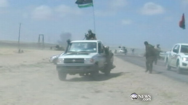 VIDEO: Libyan leaders face the pressure of NATO air strikes and advancing rebels.