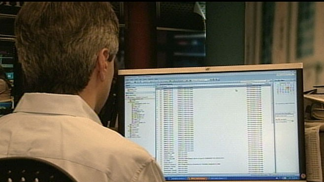 VIDEO: Companies inboxes across the globe are jammed with virus-attached emails.