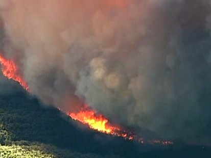 Sam Champion reports from the scene on the raging fires.