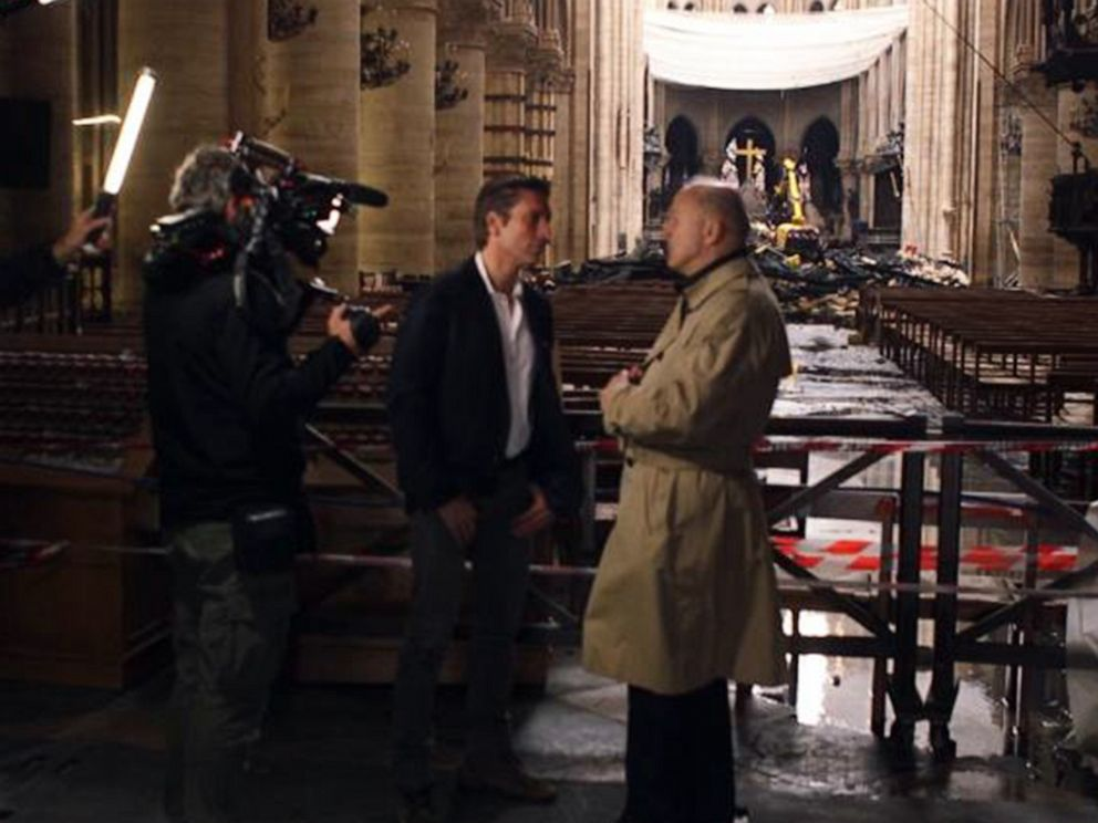 PHOTO: ABC News David Muir walks through the fire-damaged Notre Dame cathedral in Paris with retired French General Jean-Louis Georgelin in May 2019, nearly a month after a devastating fire.