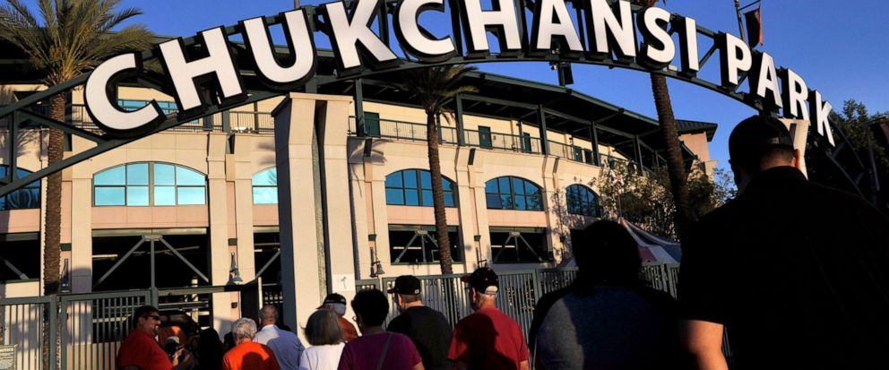 This Sept. 18, 2015 photo shows fans arrive at Chukchansi Park in Fresno, Calif., for a minor-league baseball game between the Fresno Grizzlies and the Round Rock Express. Fresno authorities say a man died shortly after competing in a taco-eating con
