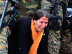 PHOTO: A woman cries as she crawls through a block of border police in the southern Macedonian town of Gevgelija, Sept. 10, 2015.
