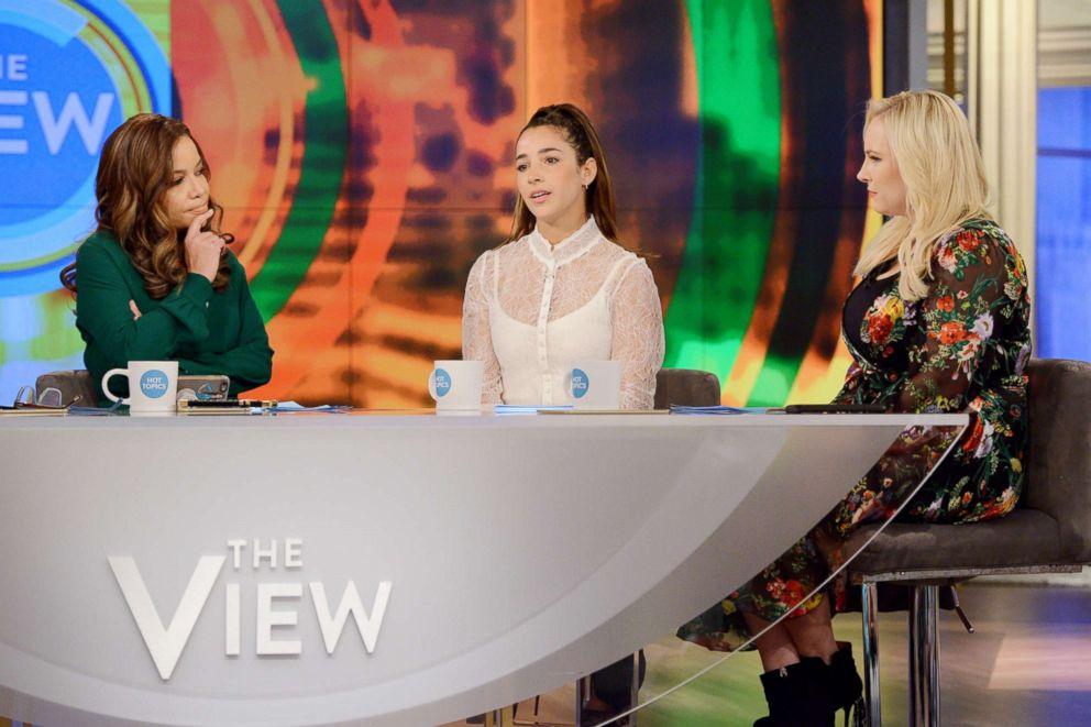 PHOTO: Aly Raisman speaks on The View as co-hosts Sunny Hostin, left, and Meghan McCainon listen, Jan.26, 2018.