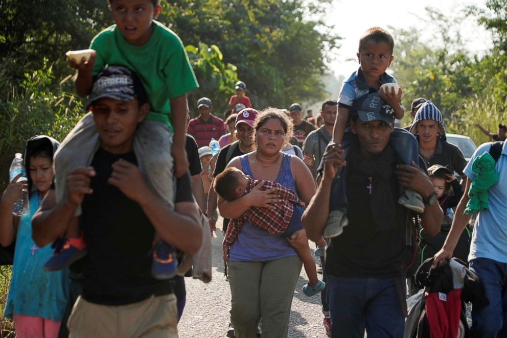 Migrants walk during their journey towards the United States, in Huixtla, Mexico, Jan. 20, 2019.