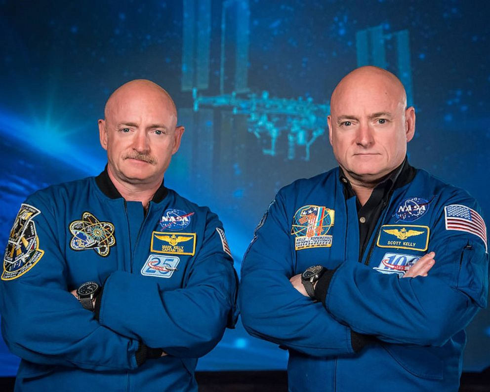 PHOTO: Astronaut Scott Kelly (R), who was the Expedition 45/46 commander during his one-year mission aboard the International Space Station, along with his twin brother, former astronaut Mark Kelly (L), circa 2019.